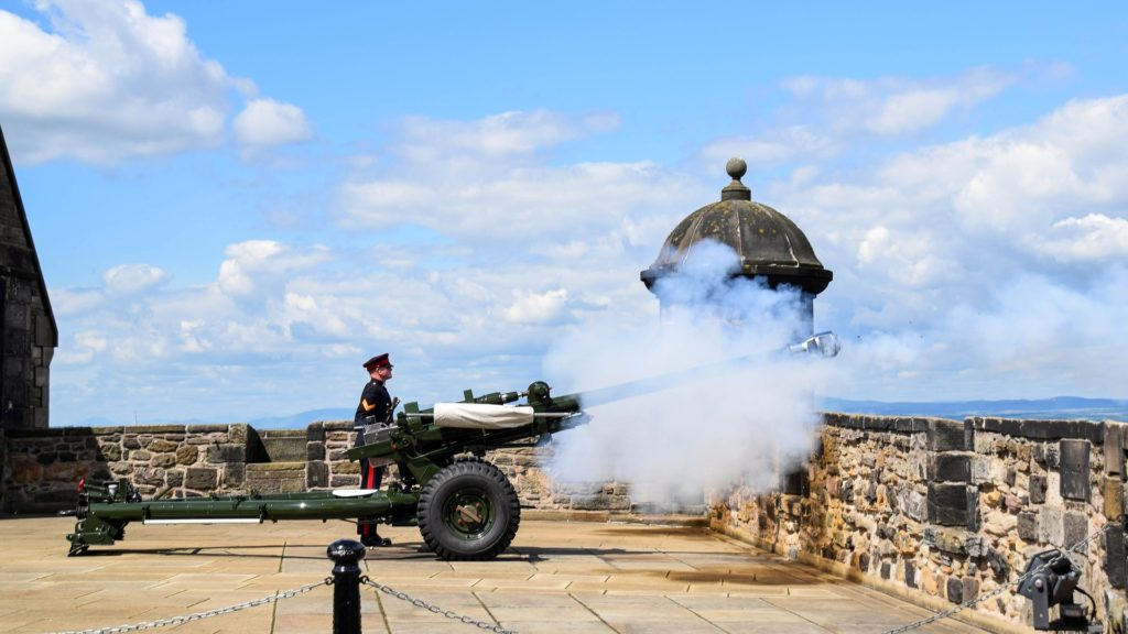 A canon being fired at Edinburgh Castle